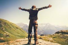 Happy Man hands raised mountaineering Stock Image