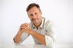 Happy man with hands on table royalty free stock image