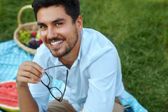 Happy Man. Handsome Smiling Young Male Outdoors In Park Royalty Free Stock Photography