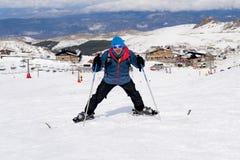 Happy man happy in snow mountains at Sierra Nevada ski resort in Spain Stock Photos