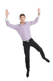 Happy man. Happy young men jumping with his hands up against white Stock Photo