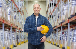 Happy man with hardhat over warehouse Royalty Free Stock Photos