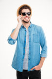 Happy man in hat and sunglasses talking on cell phone Stock Images