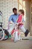 Happy man having fun outdoor buying new bicycle his girl in store. Happy men having fun outdoor buying new bicycle his girl in bike store stock photography