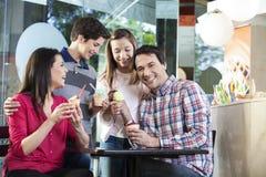 Happy Man Having Ice Cream With Family Stock Image