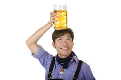 Happy man having Oktoberfest beer stein on head Royalty Free Stock Photo