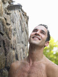 Happy Man Having Shower Outdoors Royalty Free Stock Images