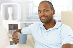 Happy man having tea at home Royalty Free Stock Photography