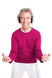 Happy man with headphones dancing Stock Photography