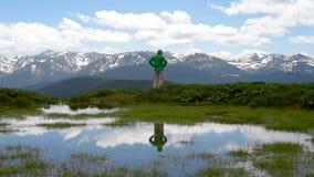 Happy man hiker enjoying landscape stock video