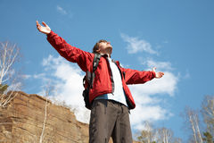 Happy man hiker holding his arms Royalty Free Stock Photo