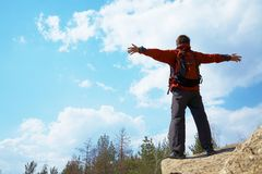 Happy man hiker holding his arms Stock Images