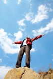 Happy man hiker holding his arms Stock Image