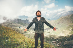 Happy Man hiking meditating in mountains. Travel Lifestyle concept adventure summer vacations outdoor hiking mountaineering bearded wayfarer Royalty Free Stock Images