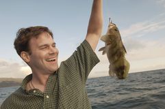 Happy Man With His Catch Royalty Free Stock Photo