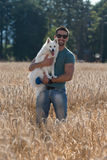 Happy Man With His Dog Outdoors Royalty Free Stock Photography