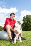 Happy man and his dog Royalty Free Stock Photo