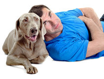 Happy man with his dog stock images