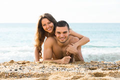 Happy man and his girlfriend  on sand beach Royalty Free Stock Photo