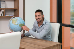 Happy Man With His Global Royalty Free Stock Photography