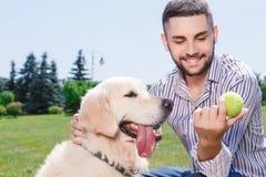 Happy man with his golden retriever Stock Image