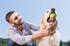 Happy man with his golden retriever Royalty Free Stock Image
