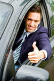Happy man in his new car Royalty Free Stock Images