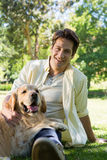 Happy man with his pet dog in park Royalty Free Stock Image