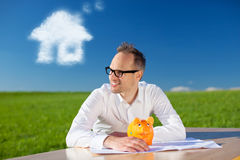 Happy man with his piggy bank Royalty Free Stock Image