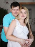 Happy man and his pregnant wife. Wife and husband. Parenthood and expecting baby Royalty Free Stock Images