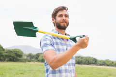 Happy man with his shovel Royalty Free Stock Images