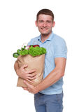Happy man hold bag with healthy food, grocery buyer isolated Royalty Free Stock Image