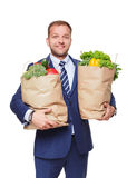 Happy man hold bag with healthy food, grocery buyer isolated Stock Photo
