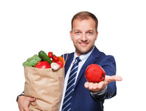 Happy man hold bag with healthy food, grocery buyer isolated Royalty Free Stock Photos
