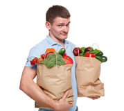 Happy man hold bags with healthy food, grocery buyer isolated Stock Photos