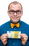 Happy man holding 200 euros. Happy man holding two hundred euros banknote isolated on white Royalty Free Stock Photography