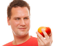 Happy man holding apple. Diet and nutrition. Stock Image