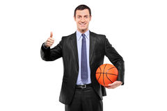 Happy man holding a ball and giving thumb up Royalty Free Stock Photo