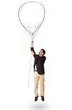 Happy man holding balloon drawing Royalty Free Stock Photo