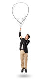 Happy man holding balloon drawing Stock Photos