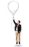 Happy man holding balloon drawing Stock Photography