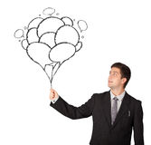 Happy man holding balloons drawing Royalty Free Stock Photography