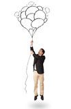 Happy man holding balloons drawing Stock Photos