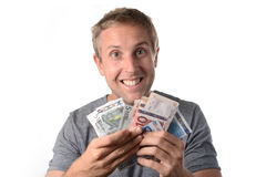 Happy man holding banknotes Royalty Free Stock Photography