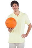 Happy man holding a basket ball Stock Images