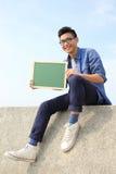 Happy man holding blackboard Royalty Free Stock Images