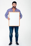 Happy man holding blank board Stock Image
