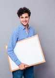 Happy man holding blank board Royalty Free Stock Image