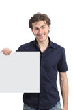 Happy man holding a blank sign or banner. Isolated on a white background Stock Photos