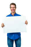 Happy man holding board Stock Photography